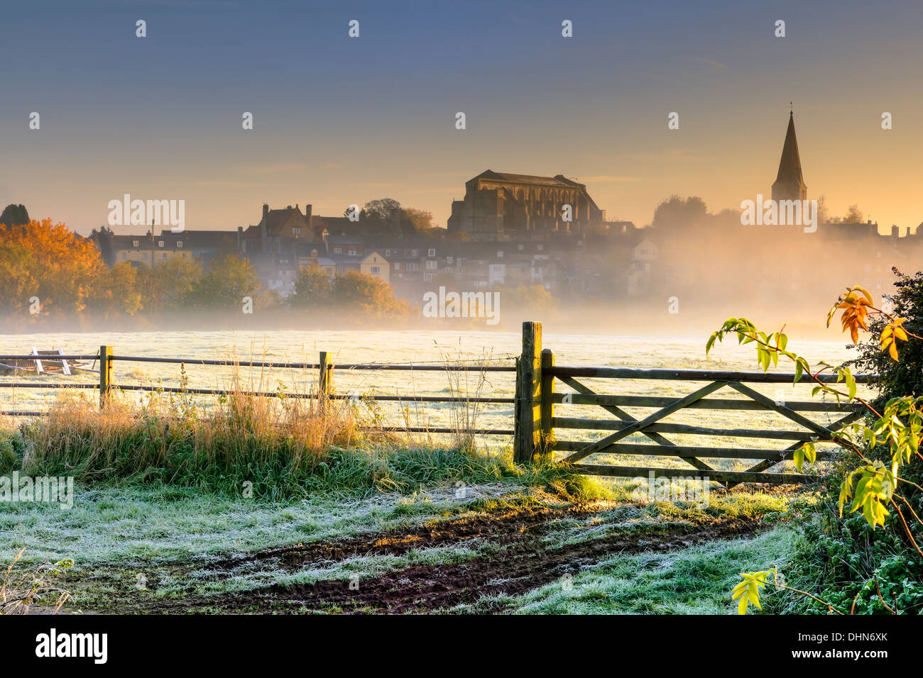 Sunrise over the Wiltshire hillside town of Malmesbury lights up the first frost in early November. Stock Photo
