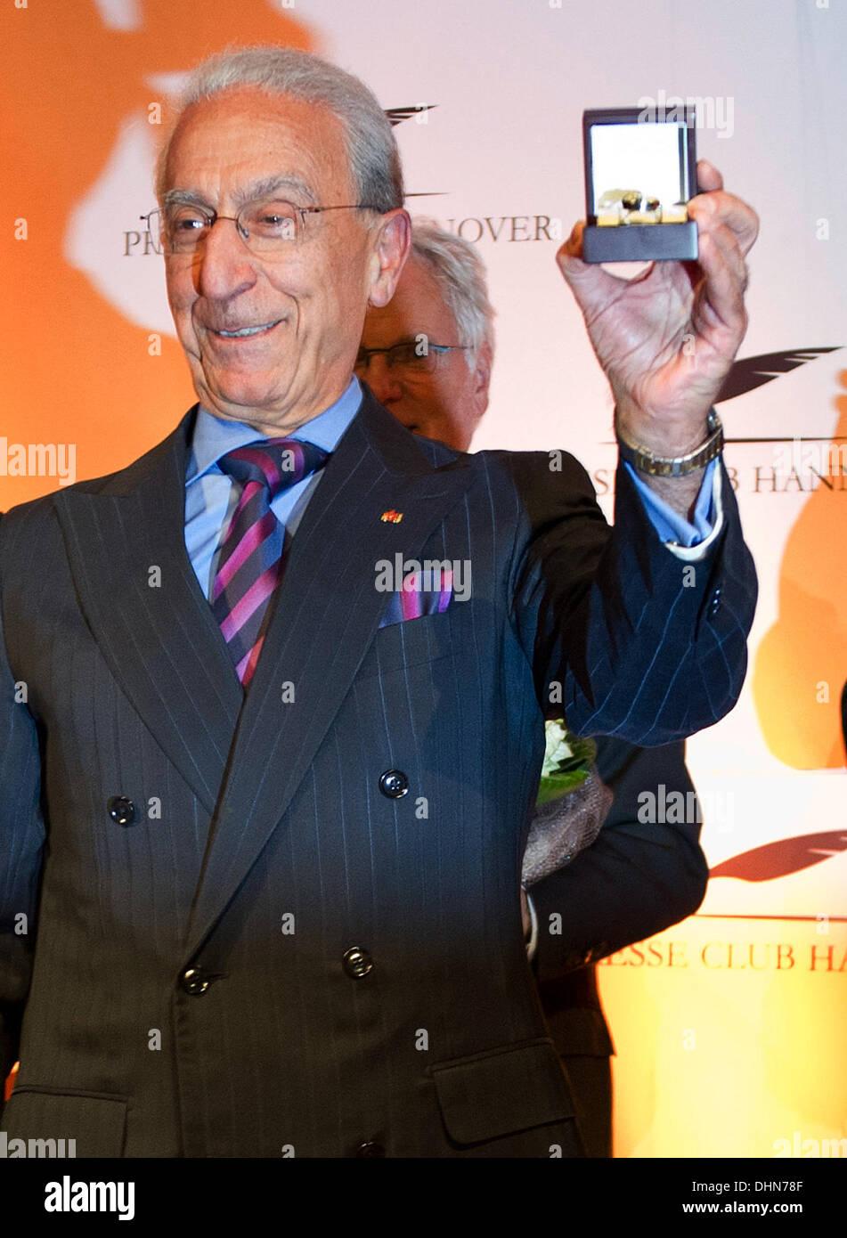 Hanover, Germany. 12th Nov, 2013. Brain surgeon Madjid Samii presents the Leibniz-Ring 2013 award, issued by the Stock Photo