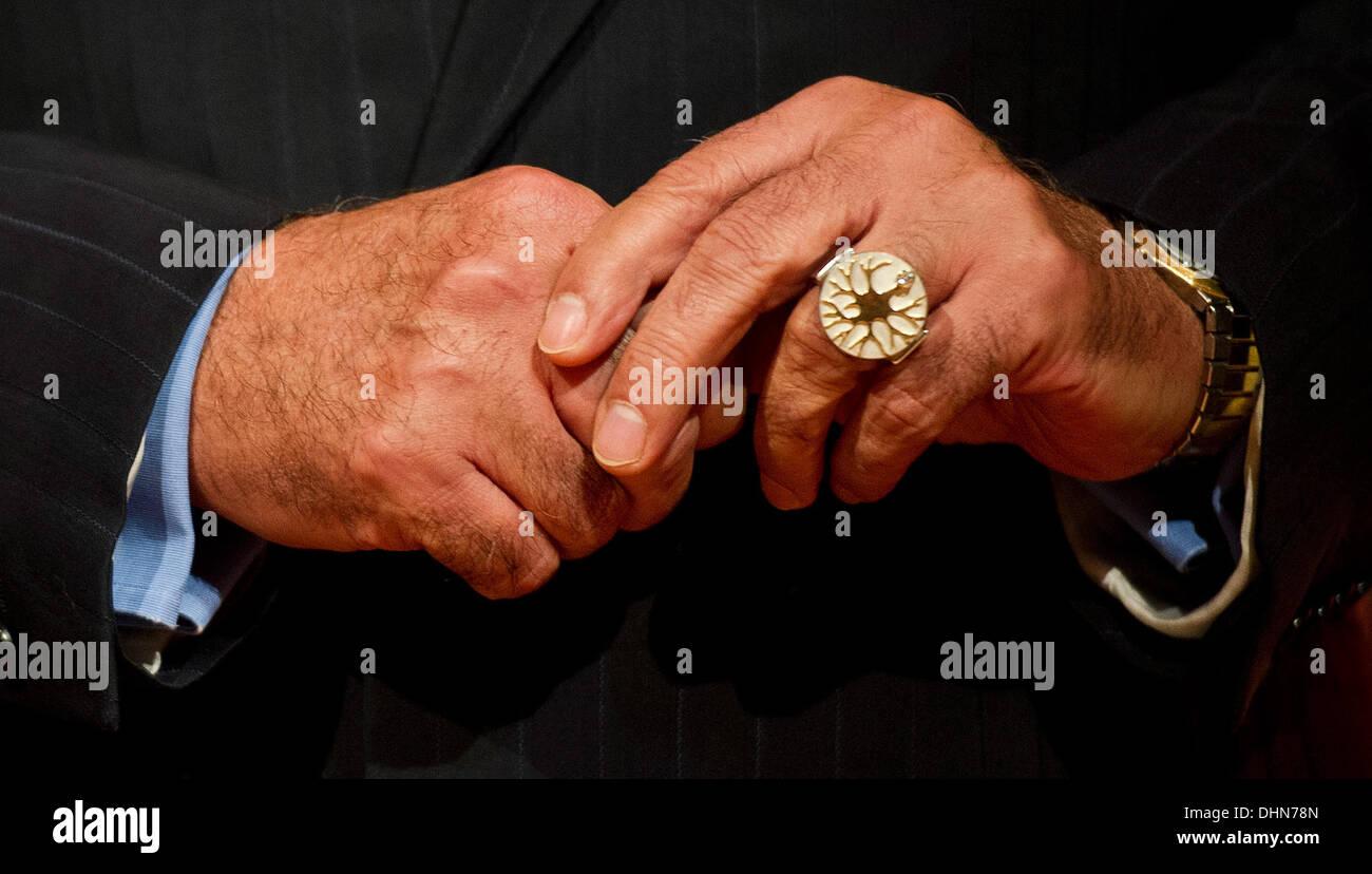 Hanover, Germany. 12th Nov, 2013. Brain surgeon Madjid Samii carries the Leibniz-Ring 2013 award on his finger, Stock Photo