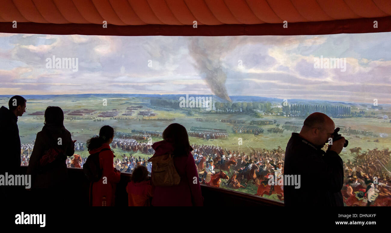 Tourists watching battlefield scenes at Panorama, museum showing a 360° fresco of Battle of Waterloo at Braine-l'Alleud, Belgium - Stock Image