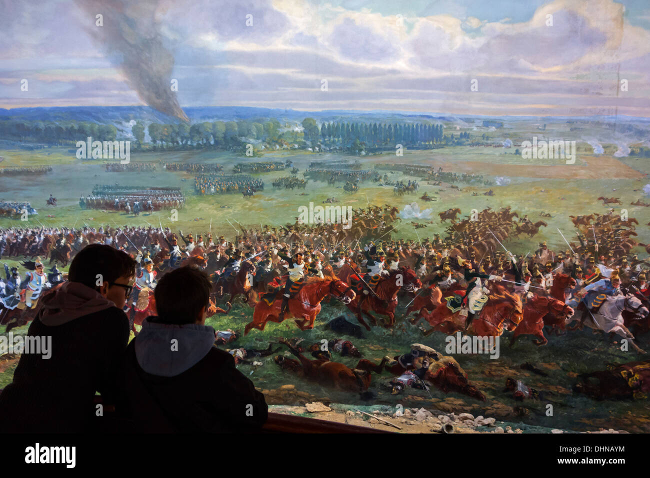 Children watching battlefield scenes at Panorama, museum showing a 360° fresco of Battle of Waterloo at Braine-l'Alleud, Belgium - Stock Image