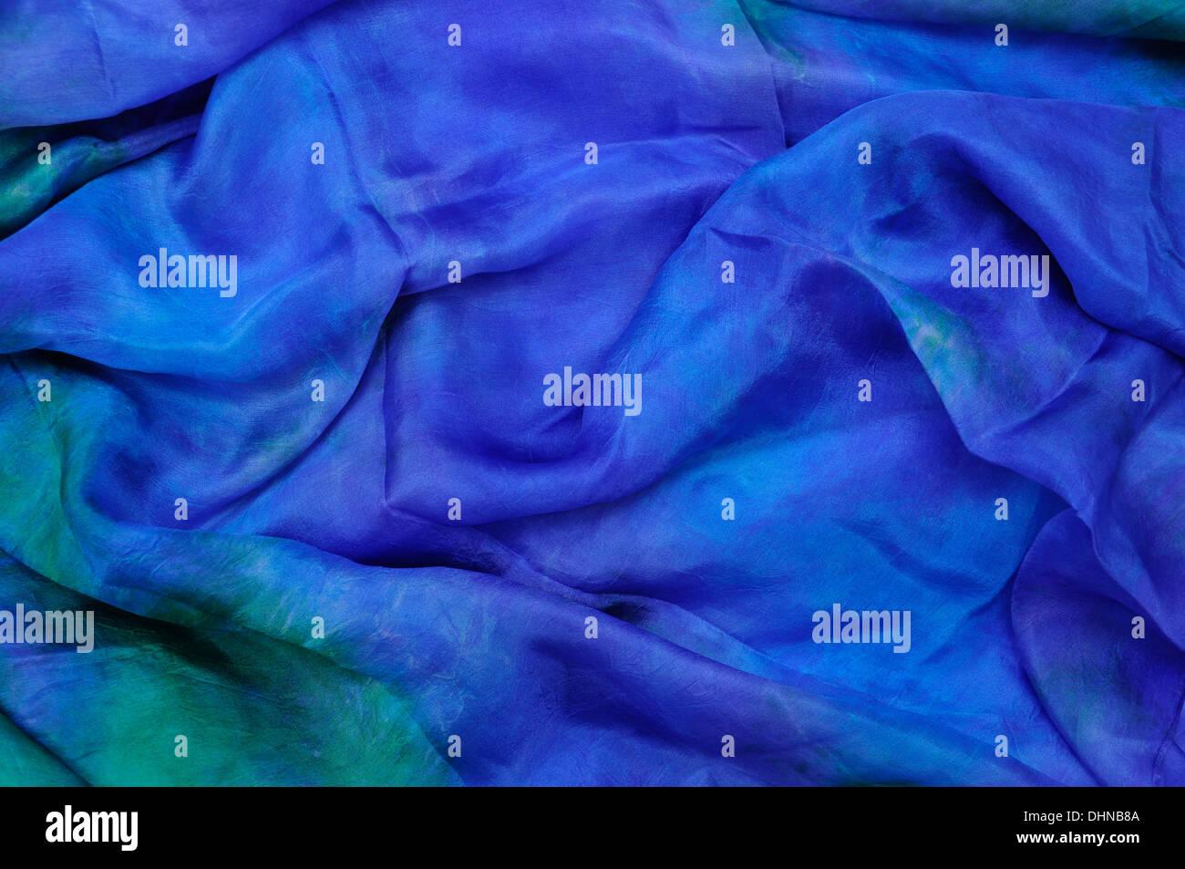 Blue silk chiffon drape background with emerald tints - Stock Image