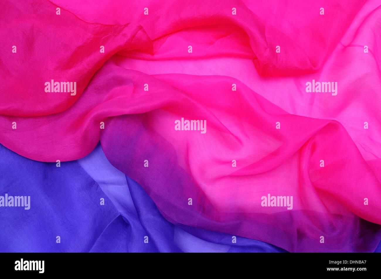 Pink and blue silk chiffon drape background - Stock Image