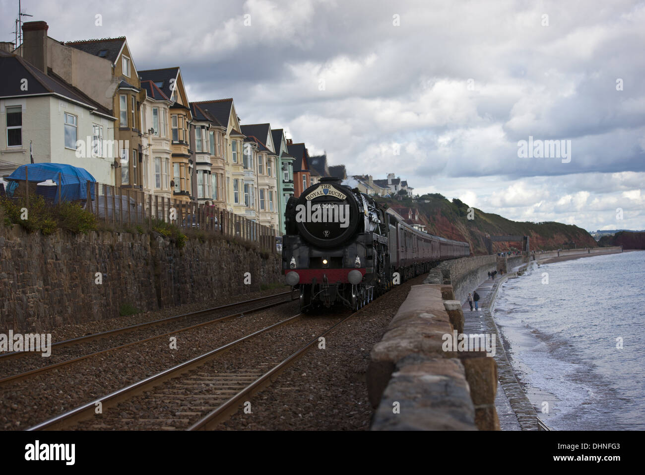 The Royal Duchy, Oliver Cromwell 70013, Steaming Along The Sea Wall - Stock Image