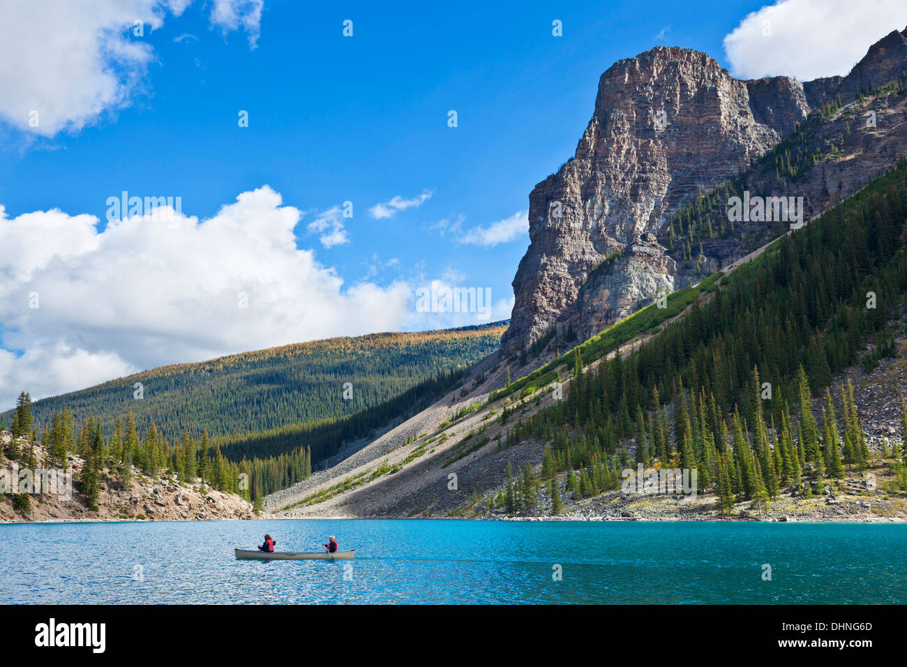 Two people  in a hire canoe on Moraine Lake Banff national Park Alberta Canada North America - Stock Image