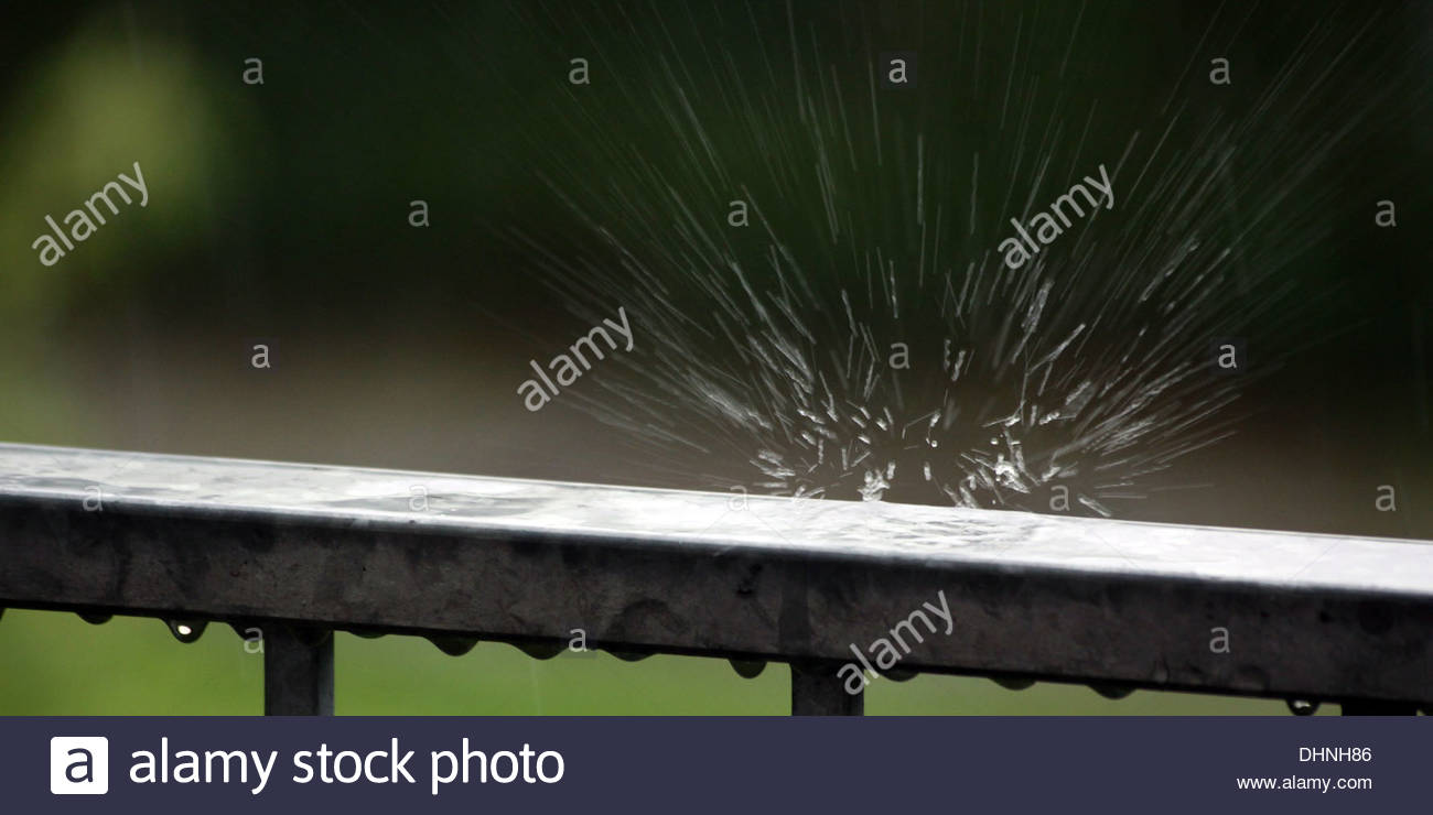 rain drop bursts on balustrade - Stock Image