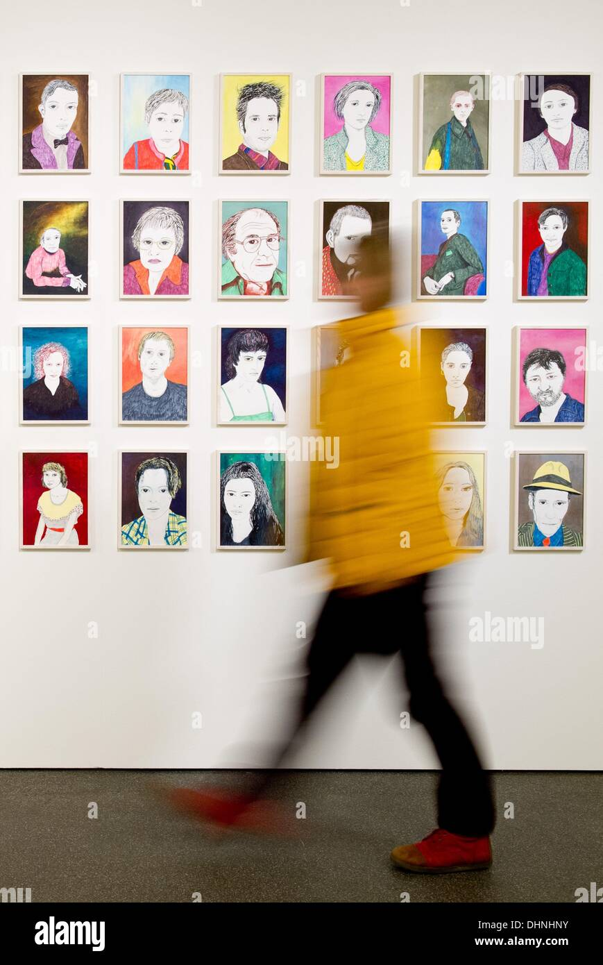 Goerlitz, Germany. 13th Nov, 2013. A woman walks past the artwork '48 portraits' by Grit Hachmeister during a media tour in the exhibition 'Localization. Contemporary Art from Saxony' in the Kulturhistorisches Museum in the Kaisertrutz in Goerlitz, Germany, 13 November 2013. The exhibition runs from 15 November 2013 to 02 March 2014. Photo: Sebastian Kahnert/dpa/Alamy Live News - Stock Image
