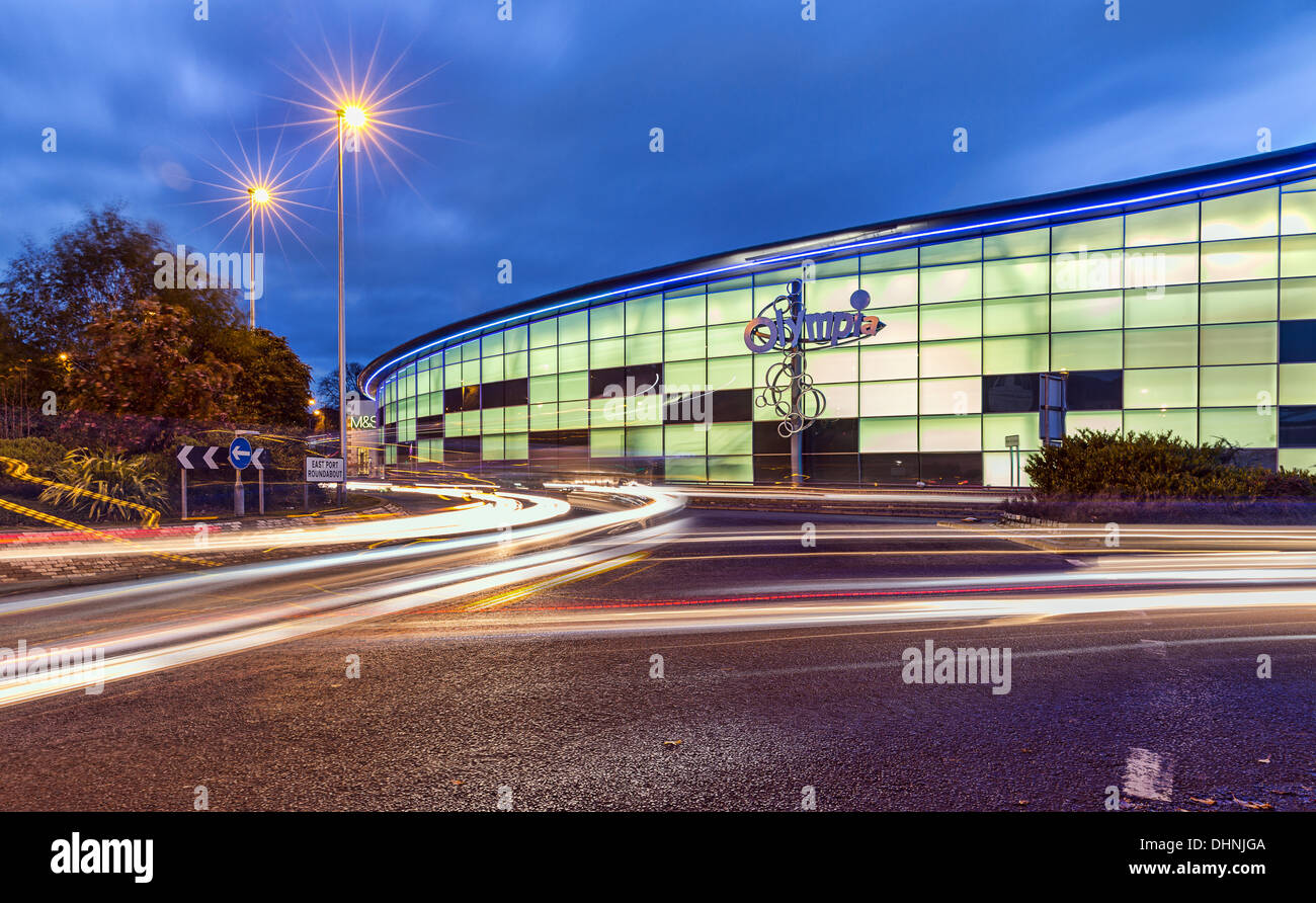 Traffic passes in front of the new Olympia Swimming Pools on East Whale Lane in Dundee, Scotland - Stock Image