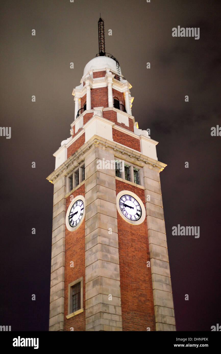 Tsim Sha Tsui Clock Tower at night. Hong Kong, China - Stock Image