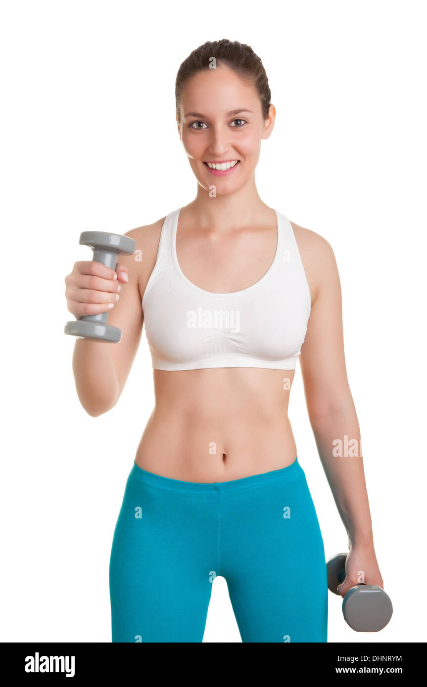 Woman working out with dumbbells at a gym - Stock Image