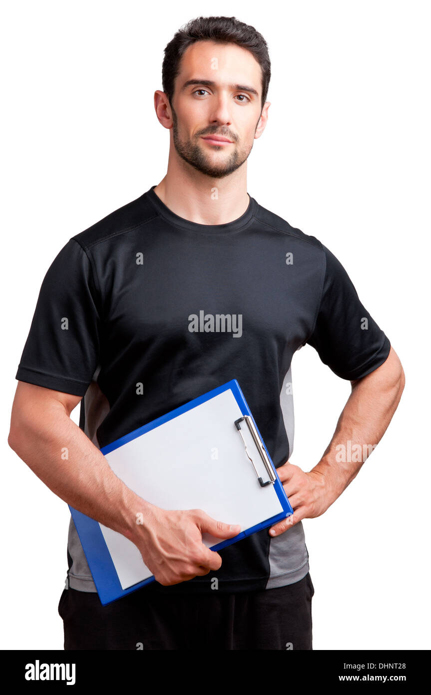 Personal Trainer, with a pad in his hand, isolated in white - Stock Image