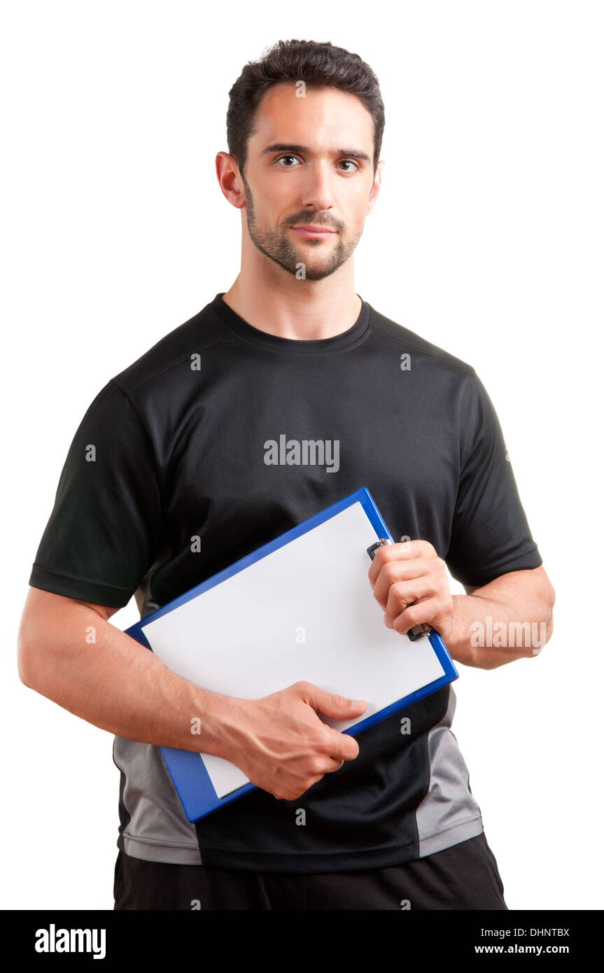 Personal Trainer, with a pad in his hand, isolated in white Stock Photo