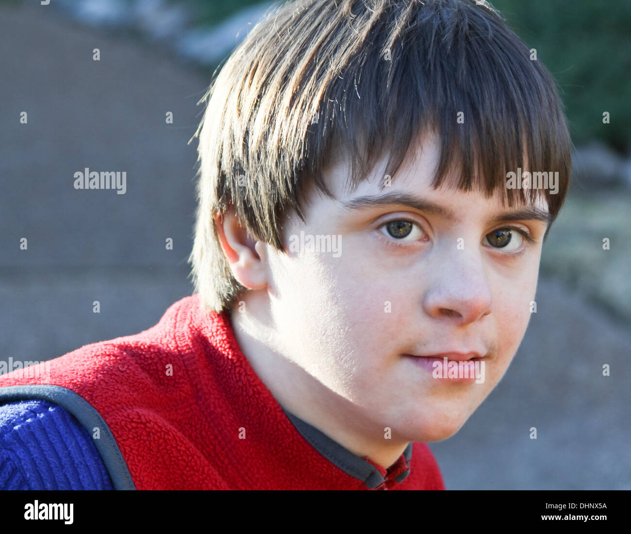 Handsome boy with Autism and Down's Syndrome - Stock Image