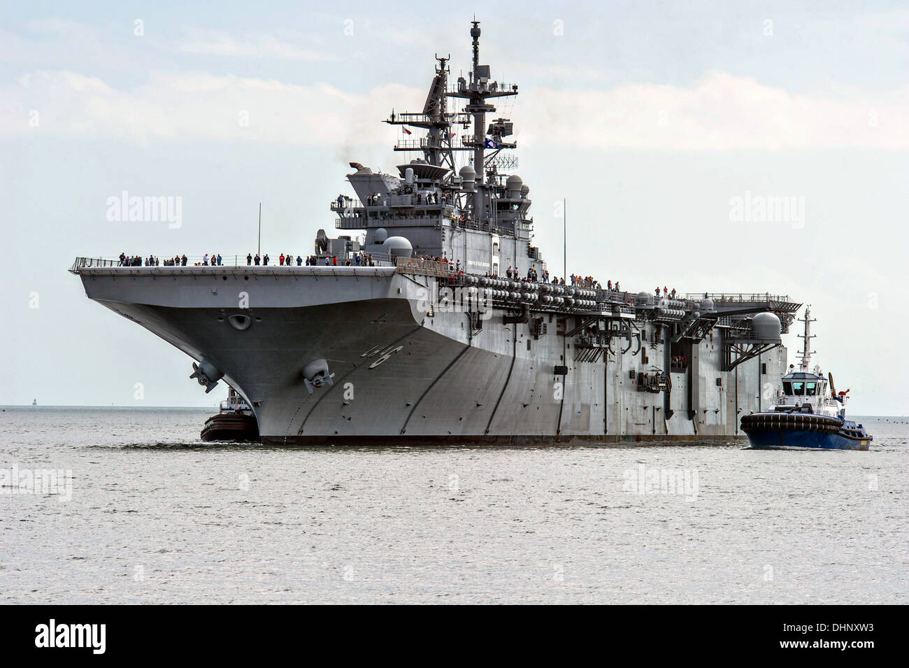 The US Navy USS America returns to Huntington Ingalls Shipyard after completing Builder's Sea Trials prior to commissioning November 9, 2013 in Pascagoula, MS. The America will be the first ship of its class, replacing the Tarawa class of amphibious assault ships. - Stock Image