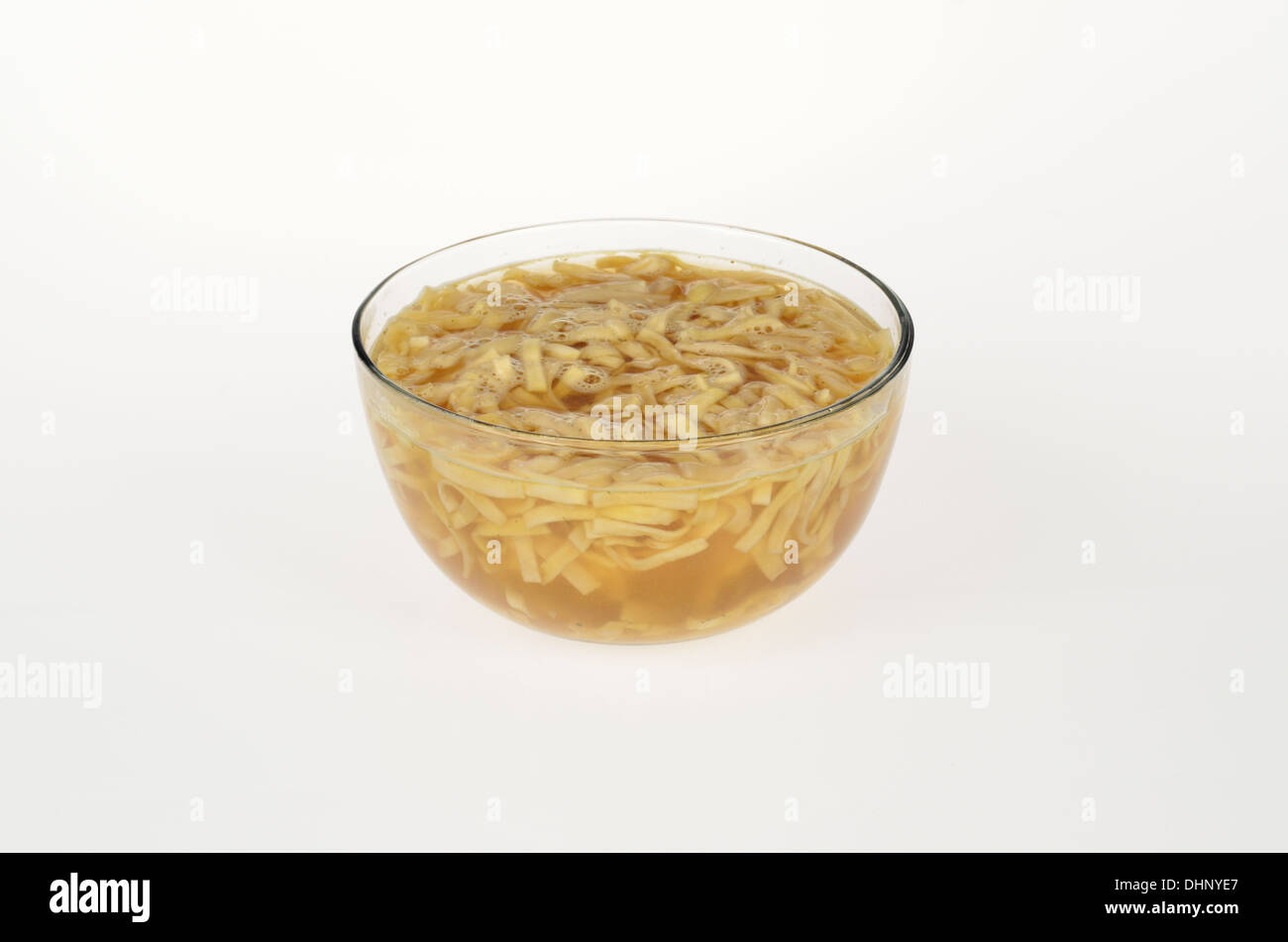 Glass Bowl of instant ramen noodles in oriental soup  on white background, cutout. USA - Stock Image
