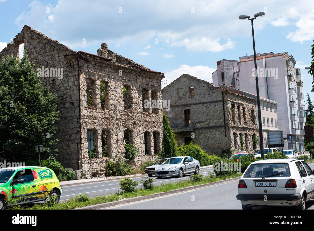 Ruined buildings can be seen everywhere in the town of Mostar. A vivid scar of the 1990s Balkan war between Croats and Bosnians. - Stock Image