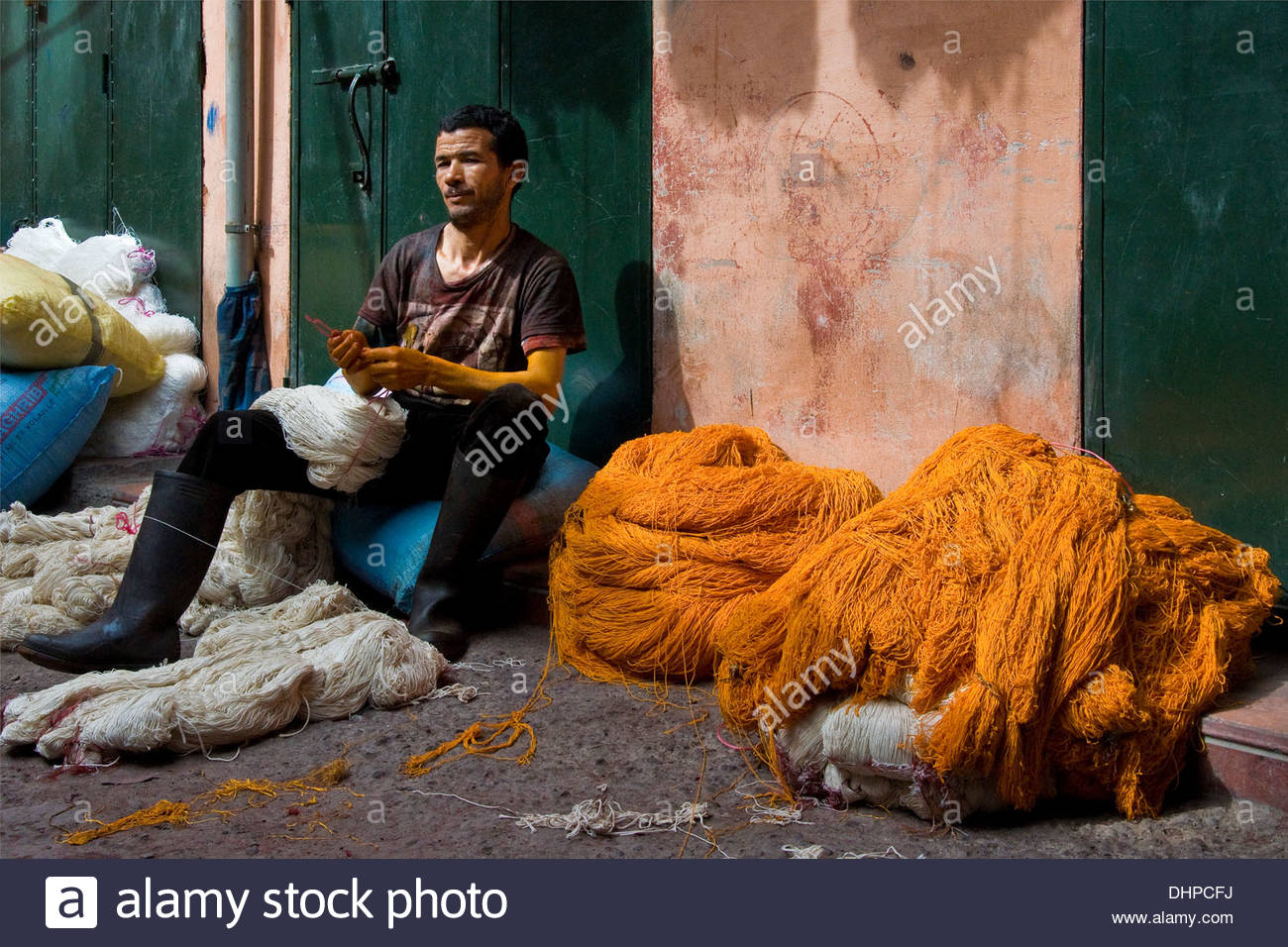 Morocco,Marrakech,Man working the wool - Stock Image
