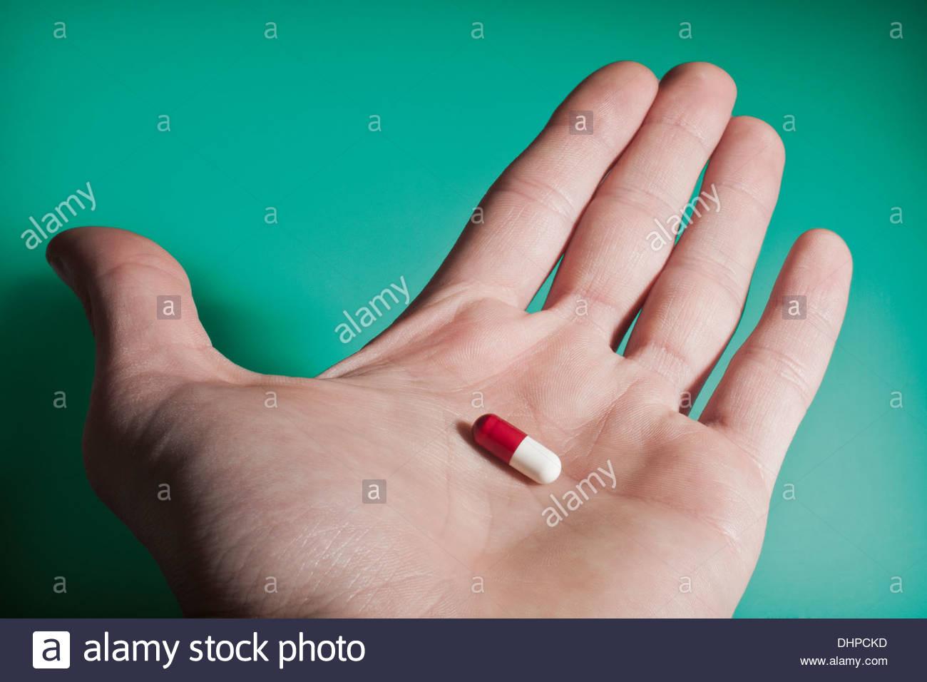 Capsule on hand - Stock Image