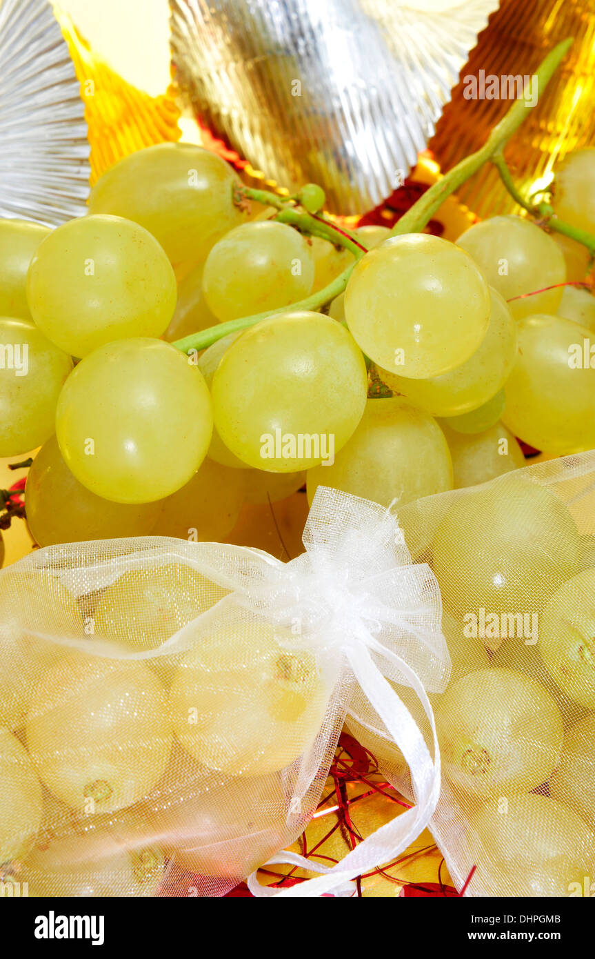 sachets with the spanish twelve grapes of luck, traditional on the New Year in Spain - Stock Image
