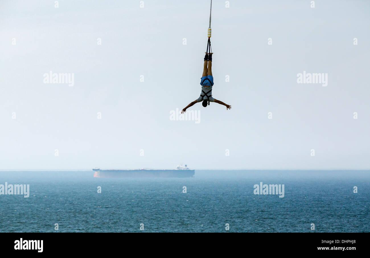 Netherlands, Scheveningen, near The Hague. Bungee jumping from Pier. Boat in background Stock Photo