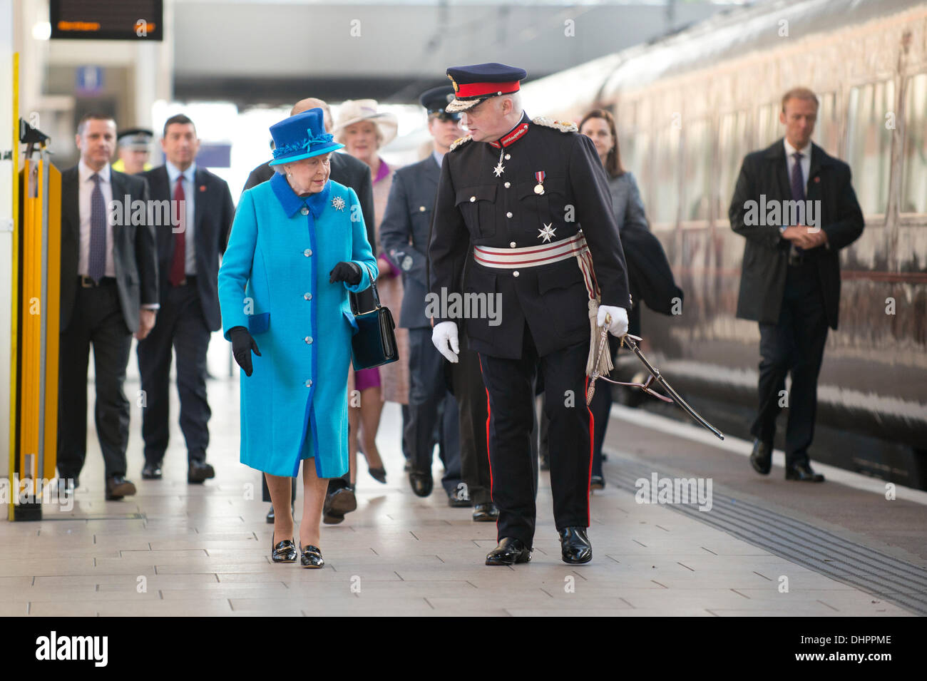 Manchester, UK. 14th November, 2013. Queen Elizabeth II and Prince Philip, Duke of Edinburgh arrive at Piccadilly Stock Photo