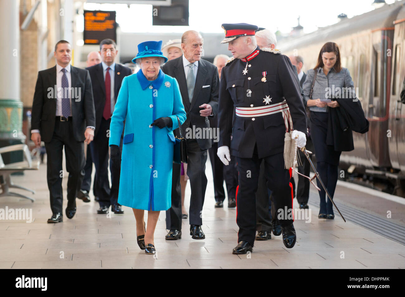 Manchester, UK. 14th November, 2013. Queen Elizabeth II and Prince Philip, Duke of Edinburgh arrive at Piccadilly Train Station in Manchester, greeted by Mr Warren J. Smith, The Lord-Lieutenant of Greater Manchester, ahead of their engagement to officially open the new 'Noma' Co-Op building in the city. Credit:  Russell Hart/Alamy Live News (Editorial use only). - Stock Image
