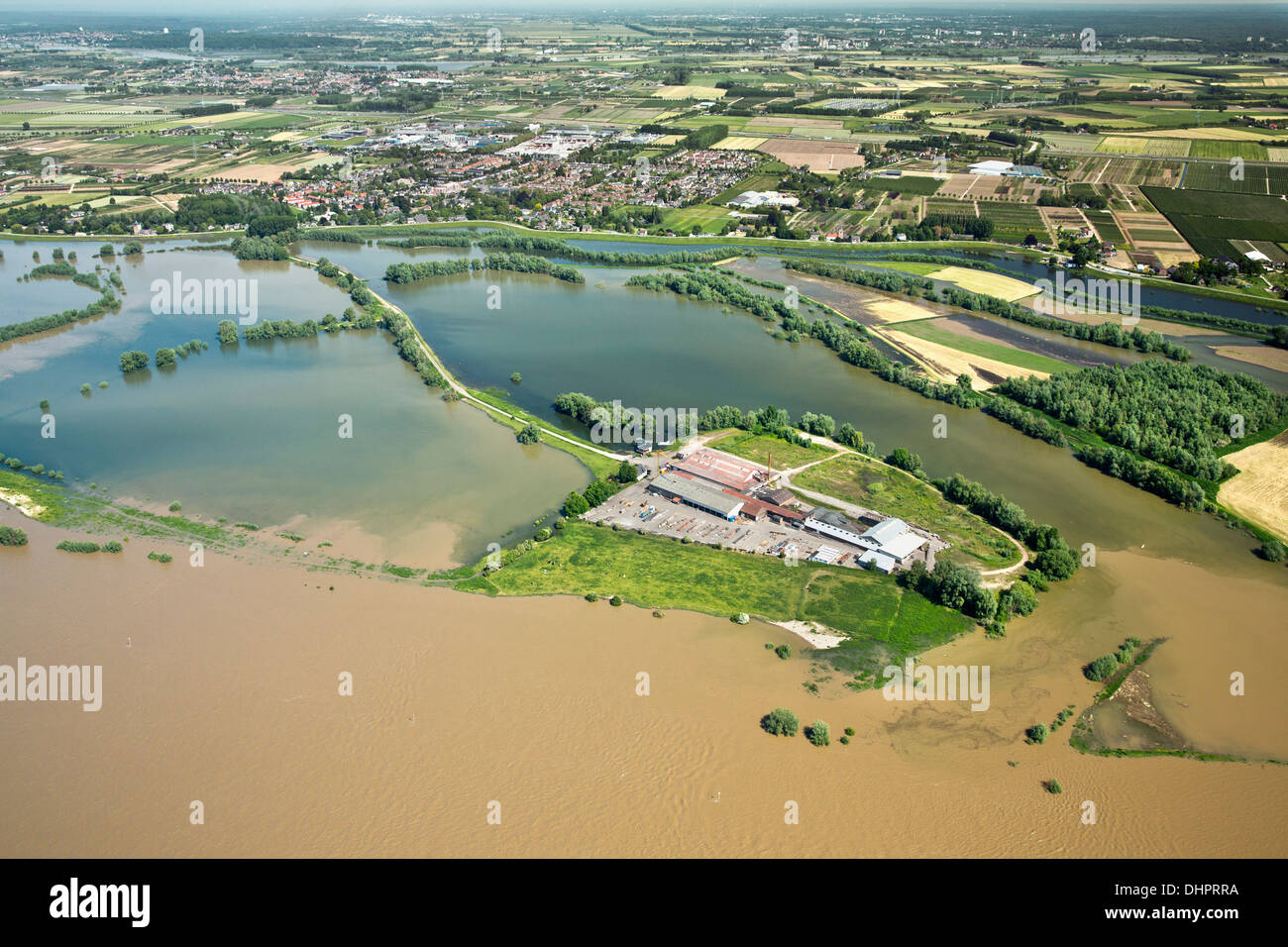 Netherlands, Dodewaard. Waal river. Flooded land and floodplains. Construction company. Aerial Stock Photo
