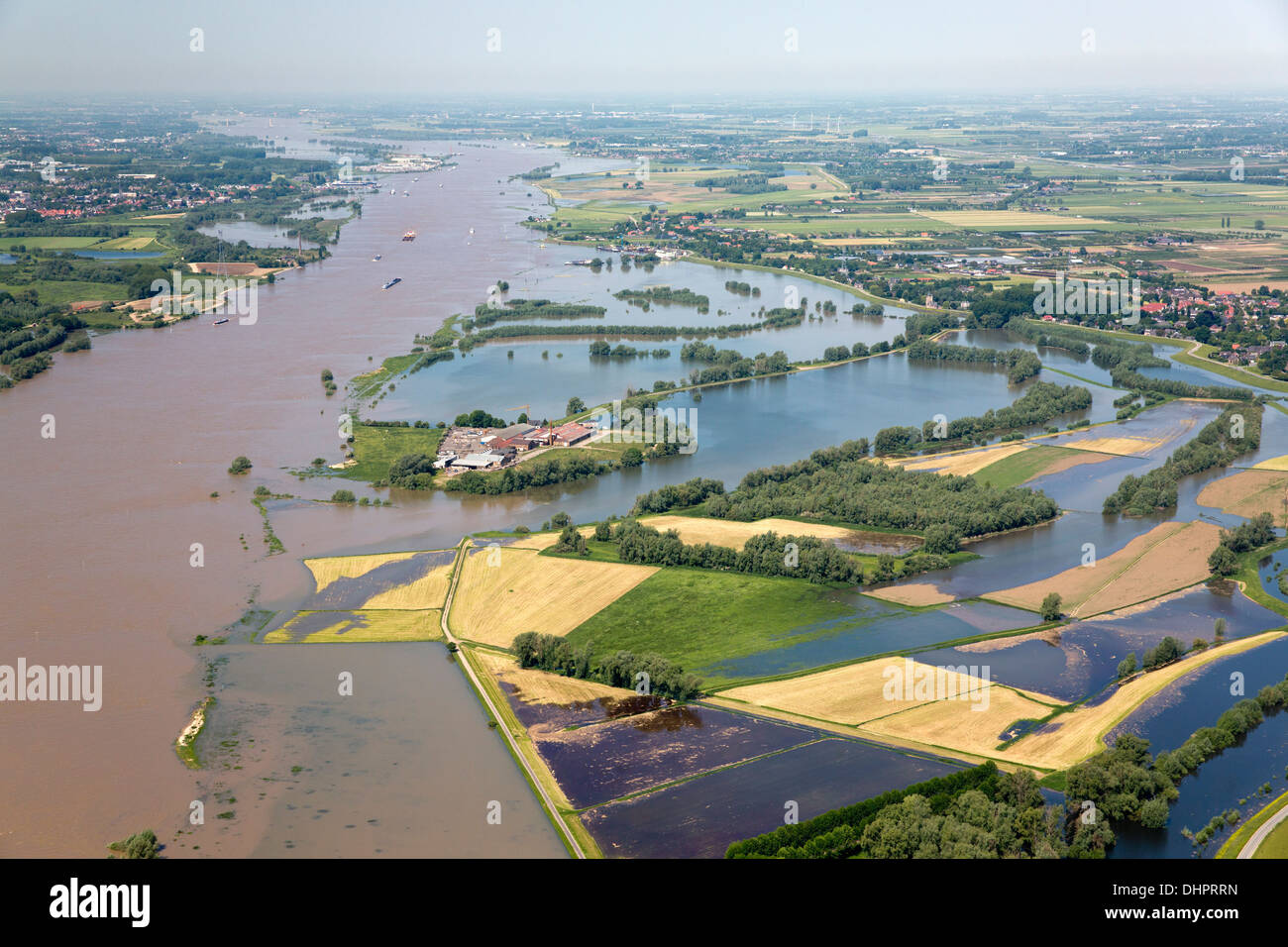 Netherlands, Dodewaard. Waal river. Flood plains. Flooded land. Construction company. Aerial Stock Photo
