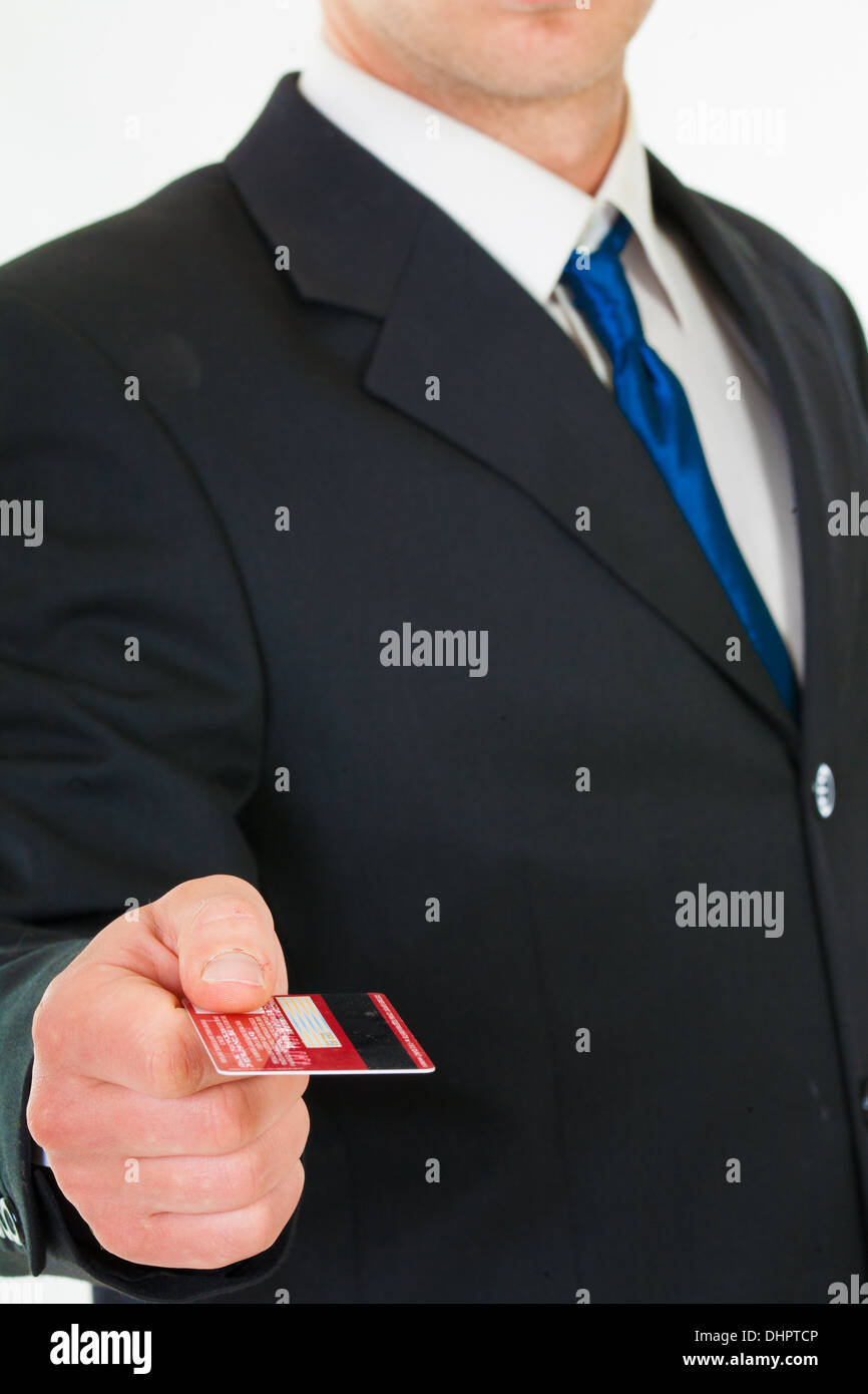 Businessman holds out a credit card. - Stock Image