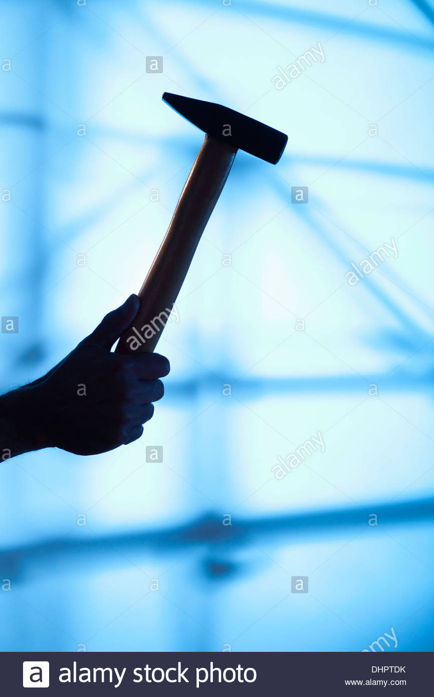 hammer detail tool DIY hand silhouette scaffolding - Stock Image