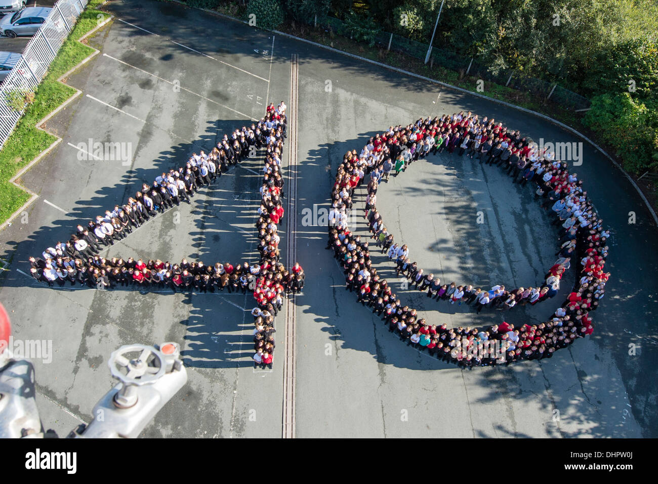 Staff and Pupils of Ysgol Penweddig Aberystwyth Wales UK make the shape of 40 to celebrate 40th anniversary of the school - Stock Image