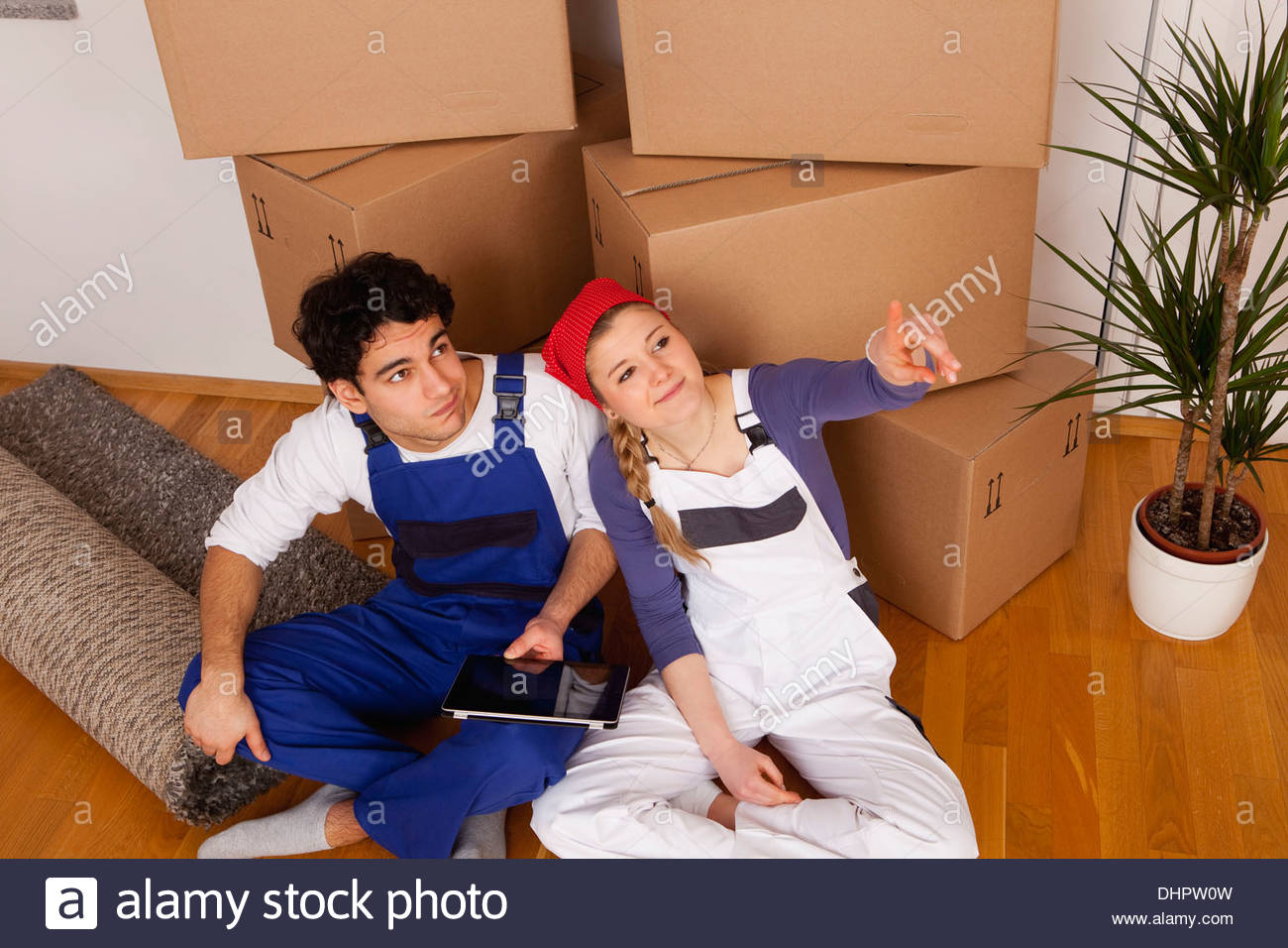 Couple planning new house Tablet PC iPad moving in - Stock Image
