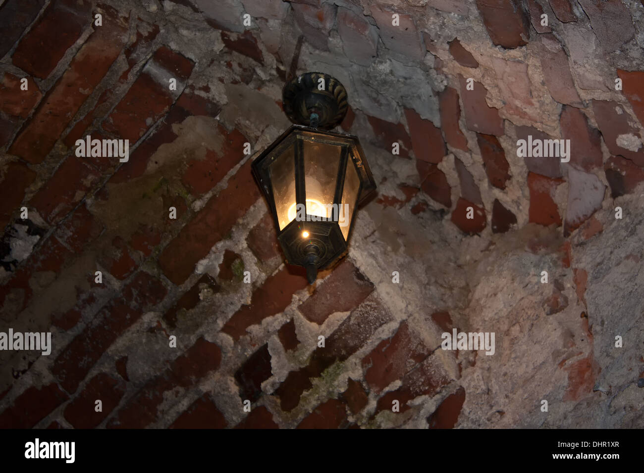 Old red bricks wall and light hanging on the wall. Dubno, Ukraine - Stock Image
