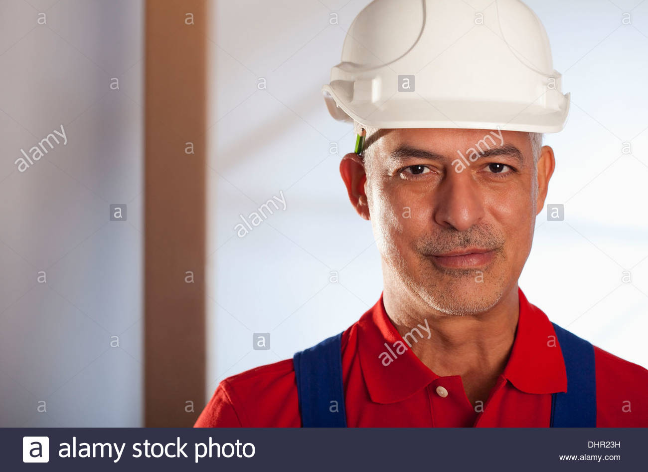 Older Construction worker helmet hard hat portrait Stock Photo