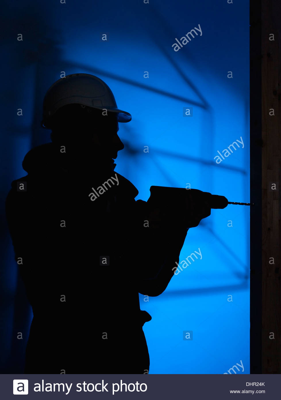 construction site man illegal worker silhouette - Stock Image