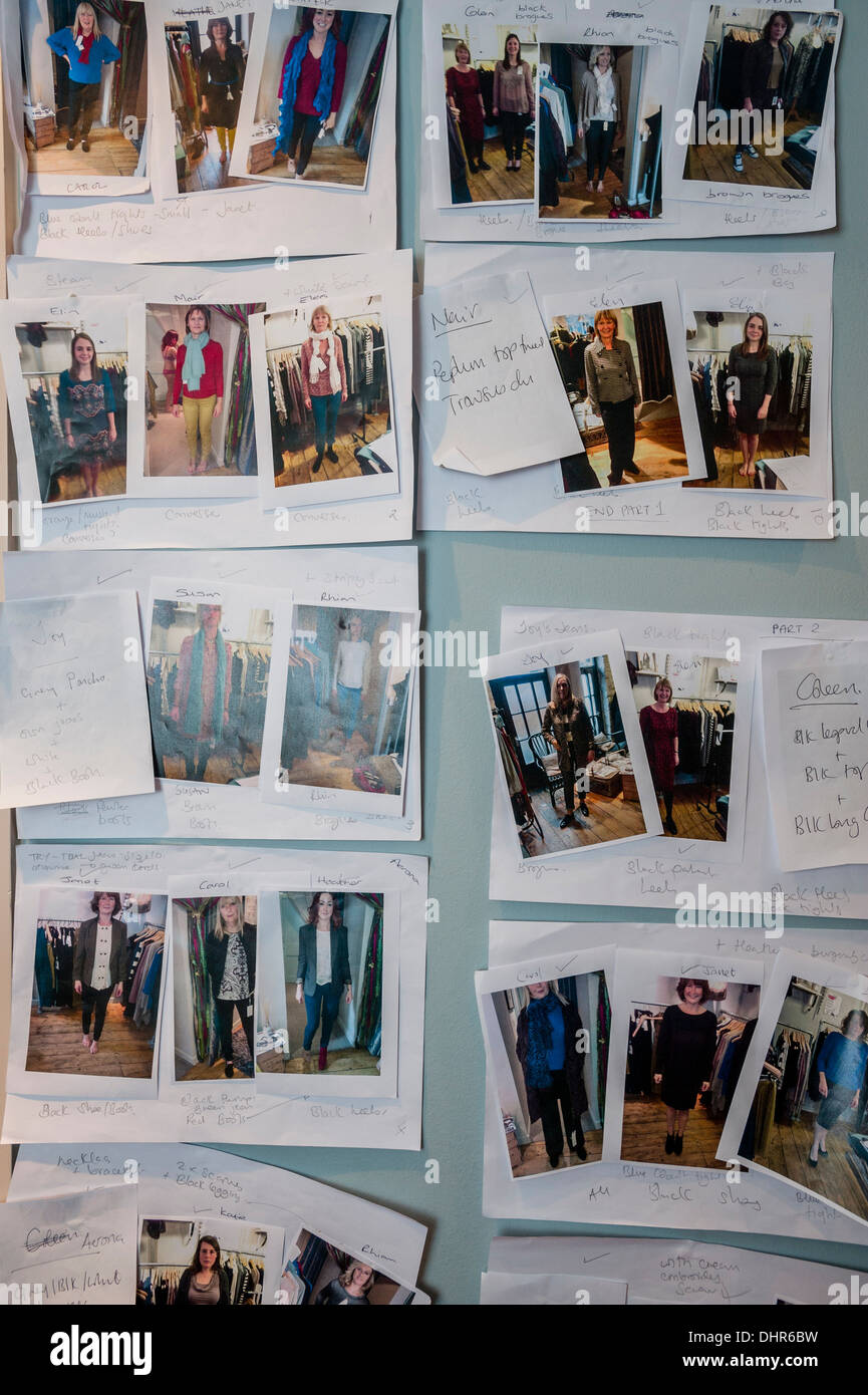 Polaroid pictures and style notes showing models clothes and accessories backstage at a catwalk fashion show UK - Stock Image