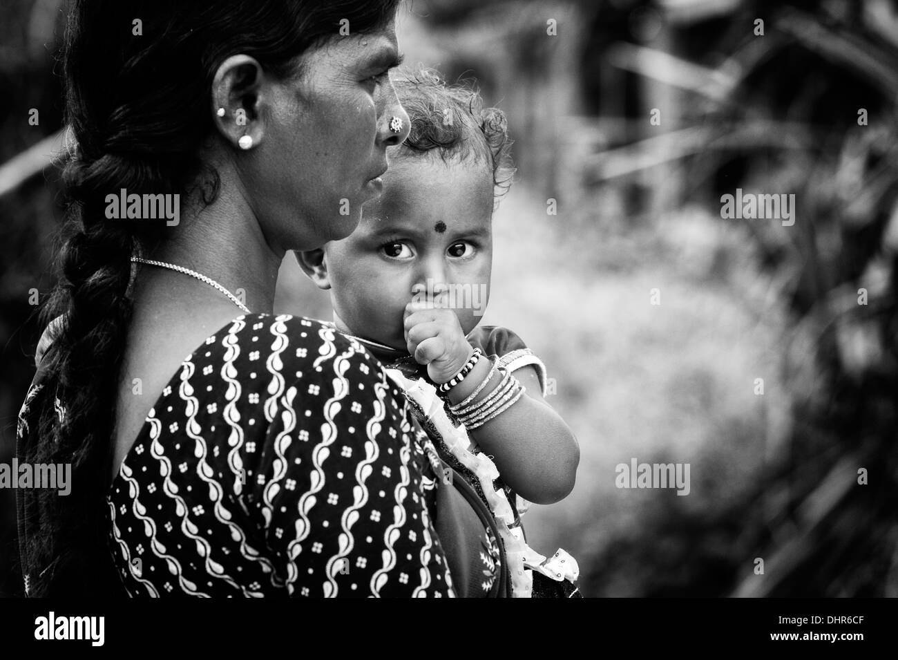 Indian mother and baby girl waiting at the sri sathya sai baba mobile outreach hospital