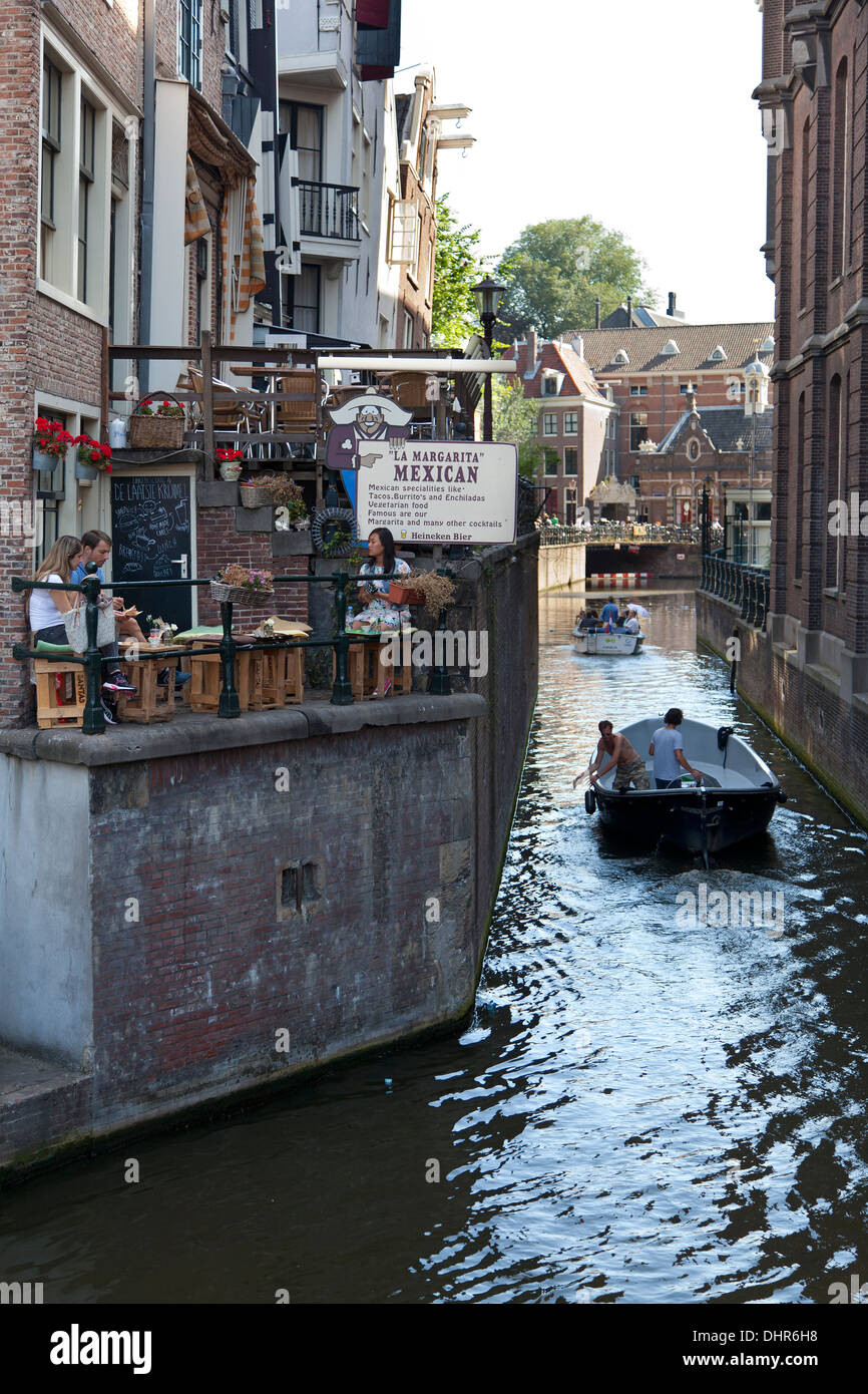Restaurant terrace above a canal in Amsterdam - Stock Image