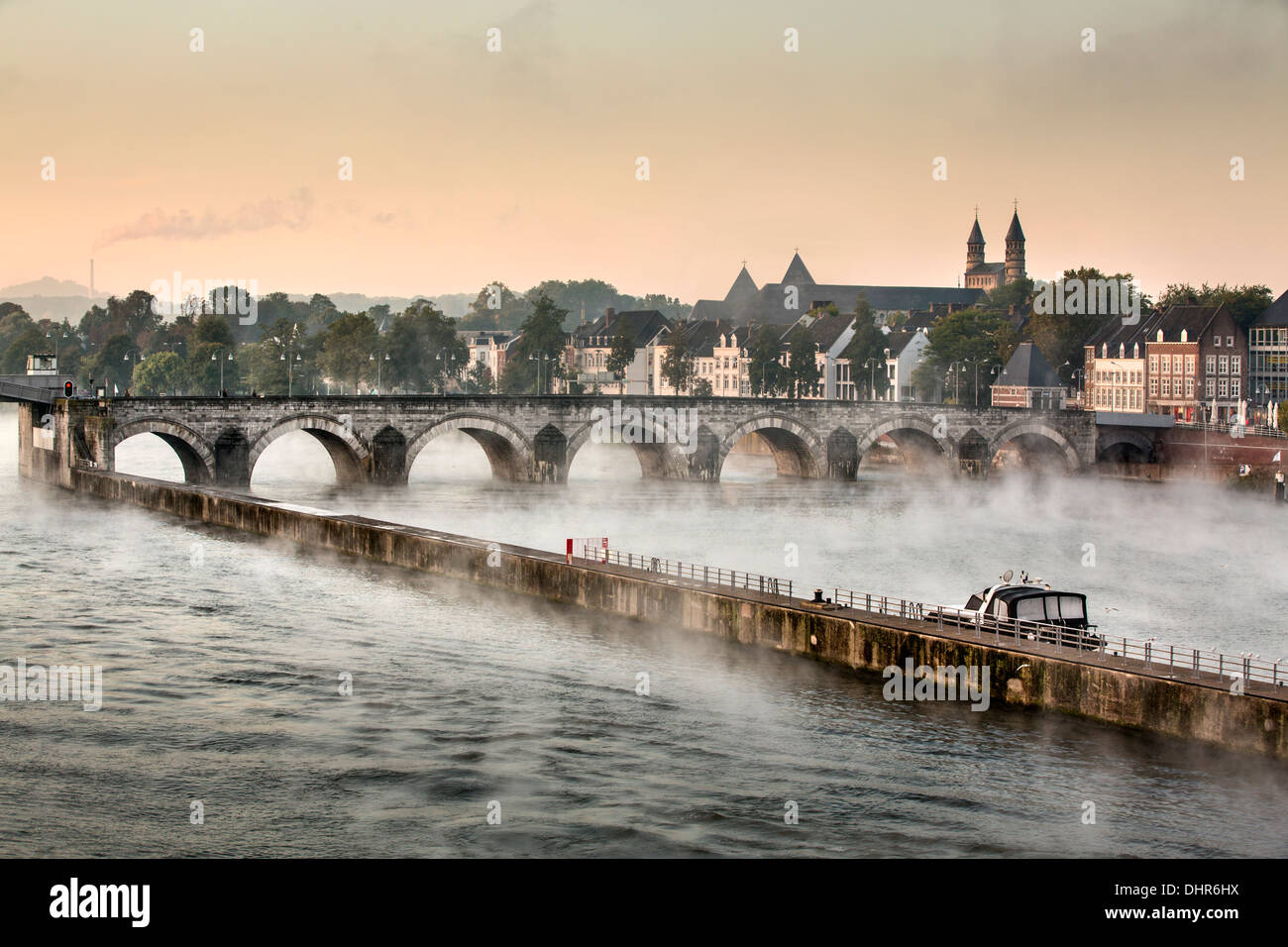 Netherlands, Maastricht, Maas or Meuse river. Bridge called Sint Servaas. Roof of church in background digitally Stock Photo