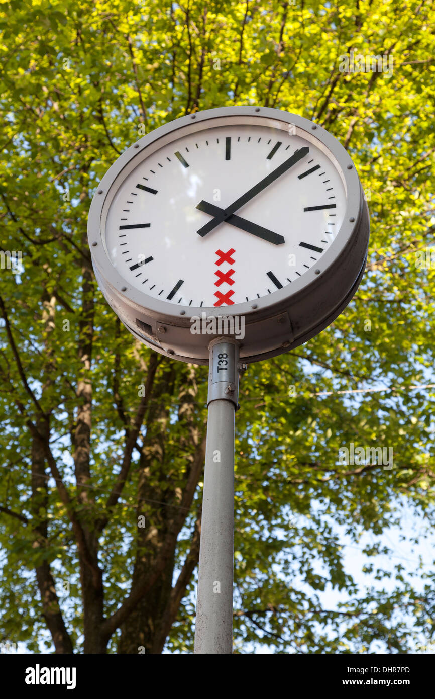 Amsterdam street clock with trhee red crosses of the Coat of arms of Amsterdam - Stock Image