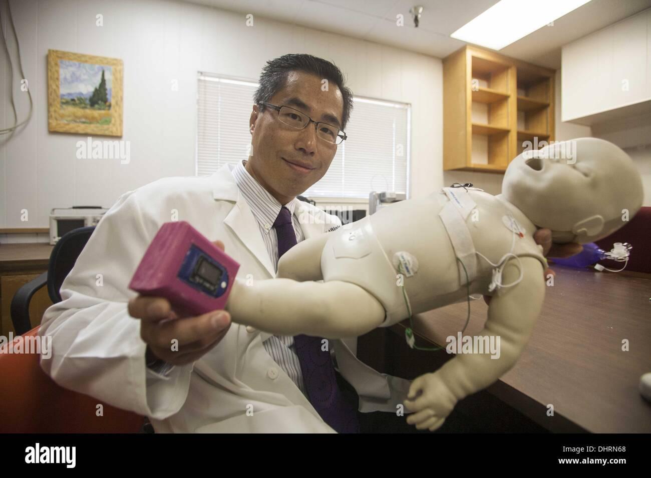 Los Angeles, California, USA. 15th Oct, 2013. Dr. Ruey-Kan Chang, founder of QT Medical, with his Pulse Oximeter. © Ringo Chiu/ZUMAPRESS.com/Alamy Live News - Stock Image