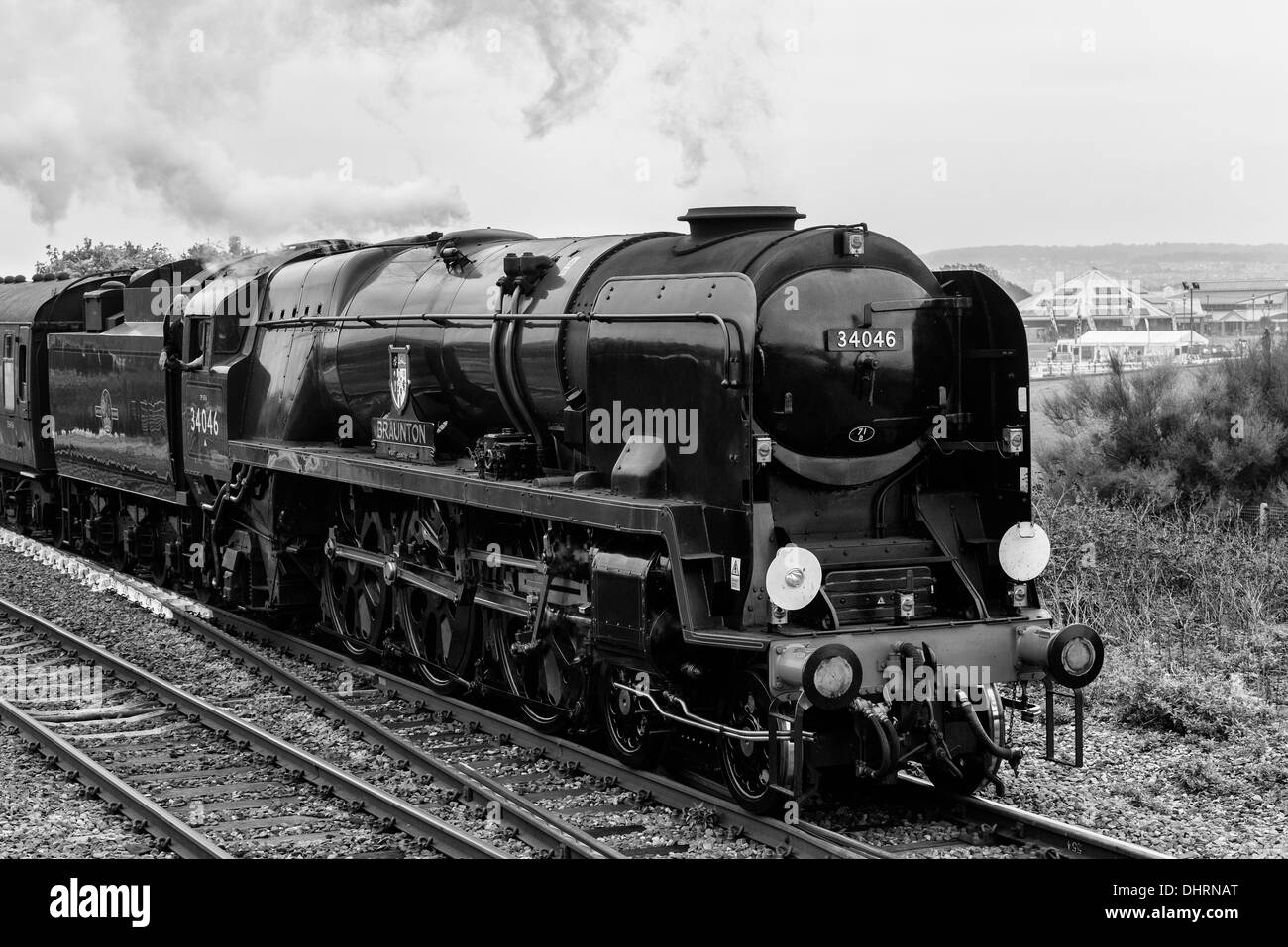 Steam locomotive 34046 Braunton leaves Dawlish Warren station with The Royal Duchy en-route from Bristol to Par - Stock Image