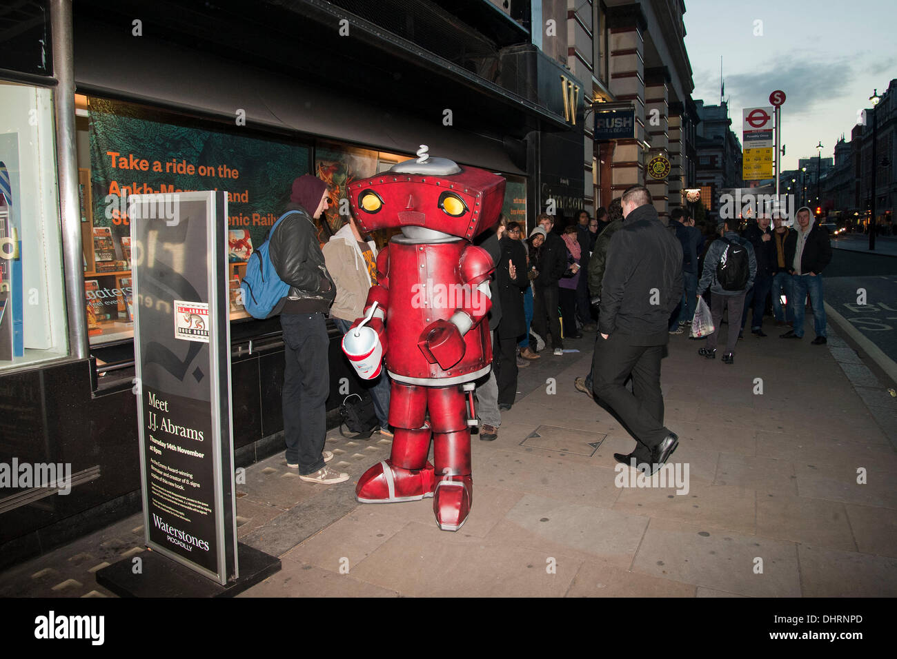 London, UK. 14th November 2013. A man dressed in a Bad Robot costume queues up with other fans outside Waterstones book shop in London's Piccadilly to have copies of S. signed by its author JJ Abrams. - Stock Image