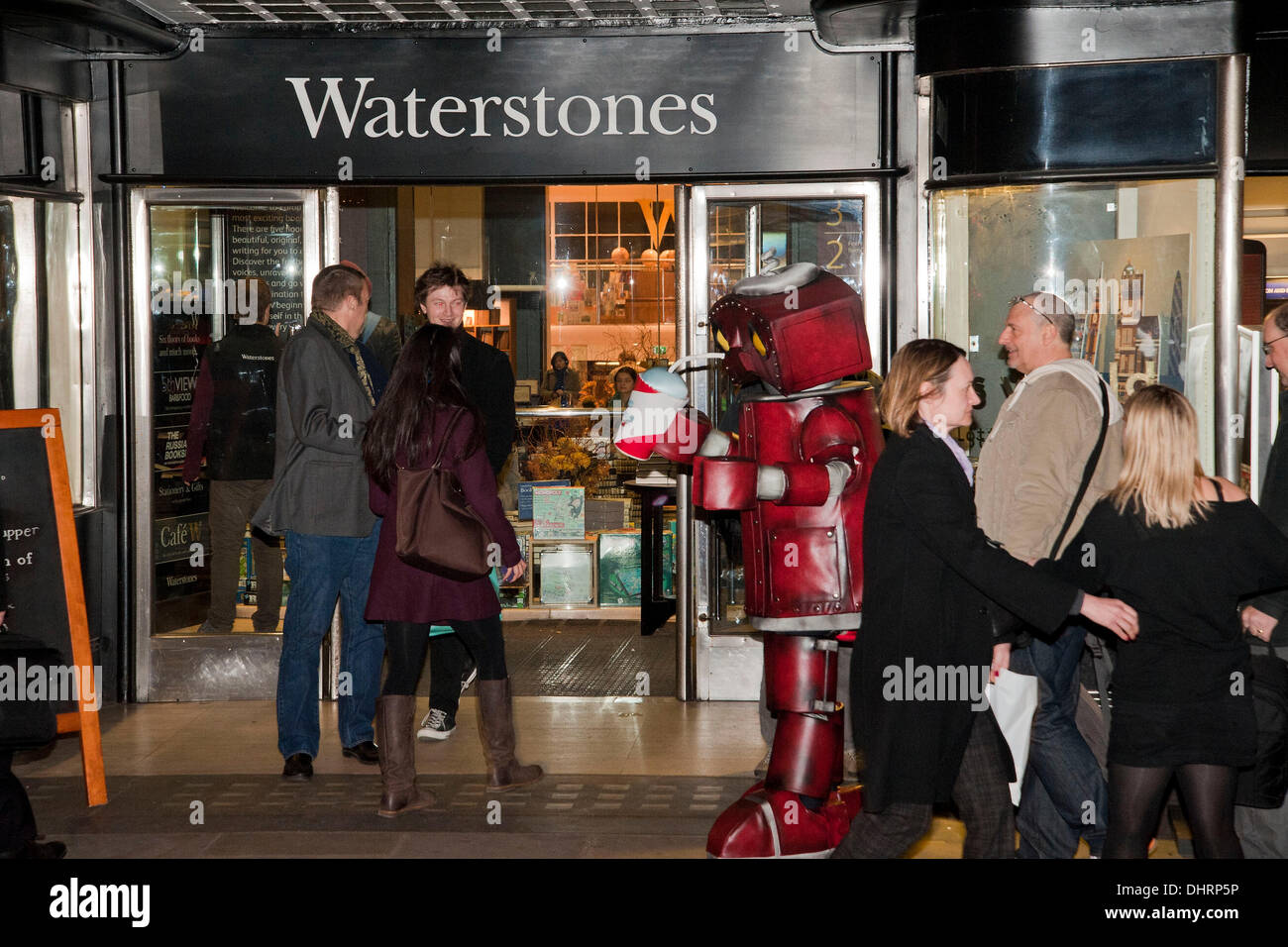 London, UK. 14th November 2013. A man dressed in a Bad Robot costume queues up with other fans outside Waterstones book shop in London's Piccadilly to have copies of S. signed by its author JJ Abrams. Credit:  Pete Maclaine/Alamy Live News - Stock Image