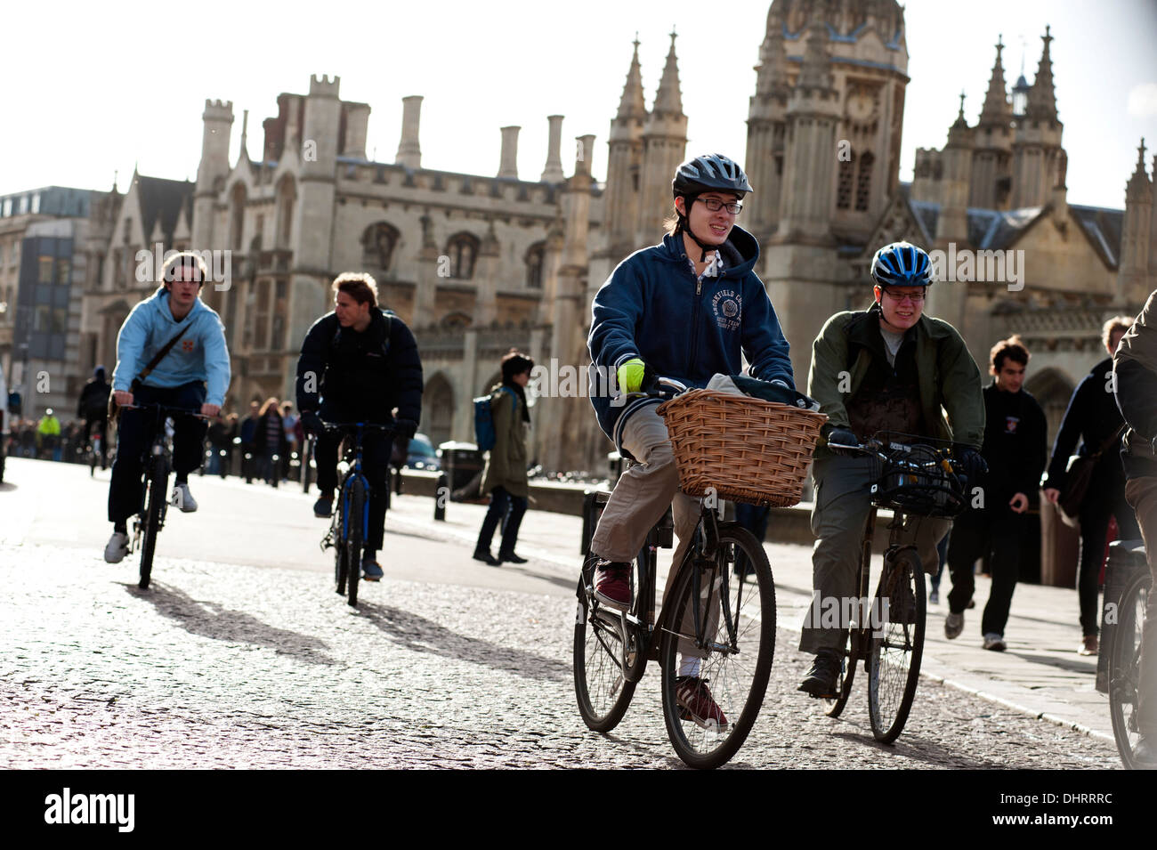 Cambridge University Students on bicycles, Cambridge, England. November 2013 Students on bicycles pass King's - Stock Image