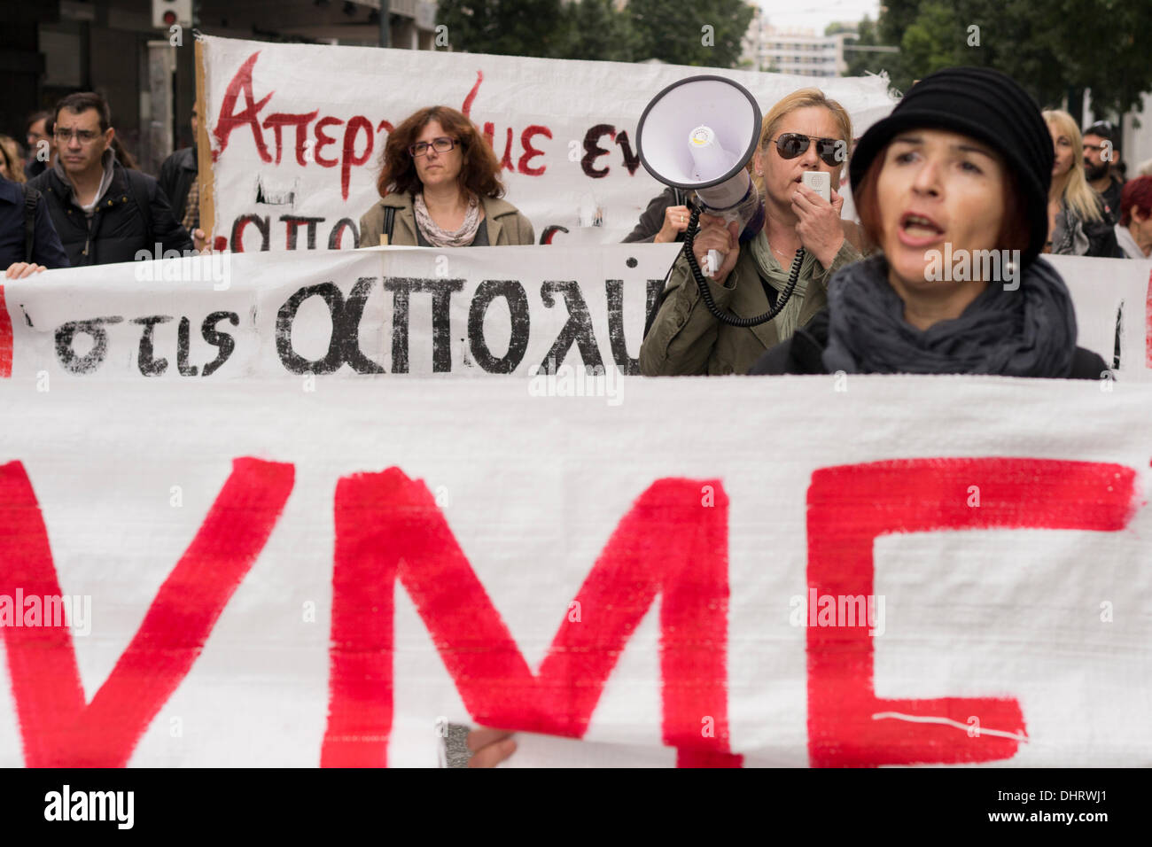 Athens, Greece. 14th November 2013. Protesters hold banners and shout slogans against the Greek government, as they march in protest of the public television, ERT's shut down and the, more than 4,000, upcoming layoffs ordered by Greece's lenders. Credit:  Nikolas Georgiou / Alamy Live News - Stock Image
