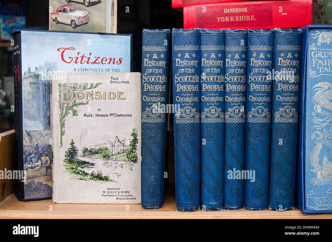 A shelf of books in a secondhand bookseller's window including volumes from 'A history of the Scottish People'. - Stock Image