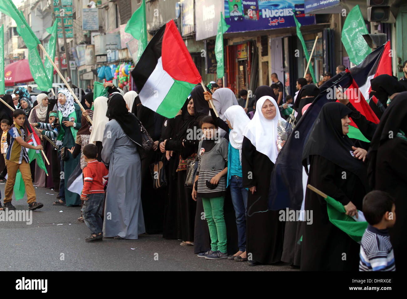Gaza City, Gaza Strip, Palestinian Territory, . 15th Nov, 2013. Palestinian women take part in an anti-Israel parade as part of the celebrations marking the first anniversary of an Israeli army operation in Gaza, on November 14, 2013. A year after trading fire in a week-long war in Gaza, in which more than 170 Palestinians and six Israelis were killed, Israel and Hamas are squaring up for another confrontation, despite both sides appearing reluctant to make the first move © Ashraf Amra/APA Images/ZUMAPRESS.com/Alamy Live News - Stock Image