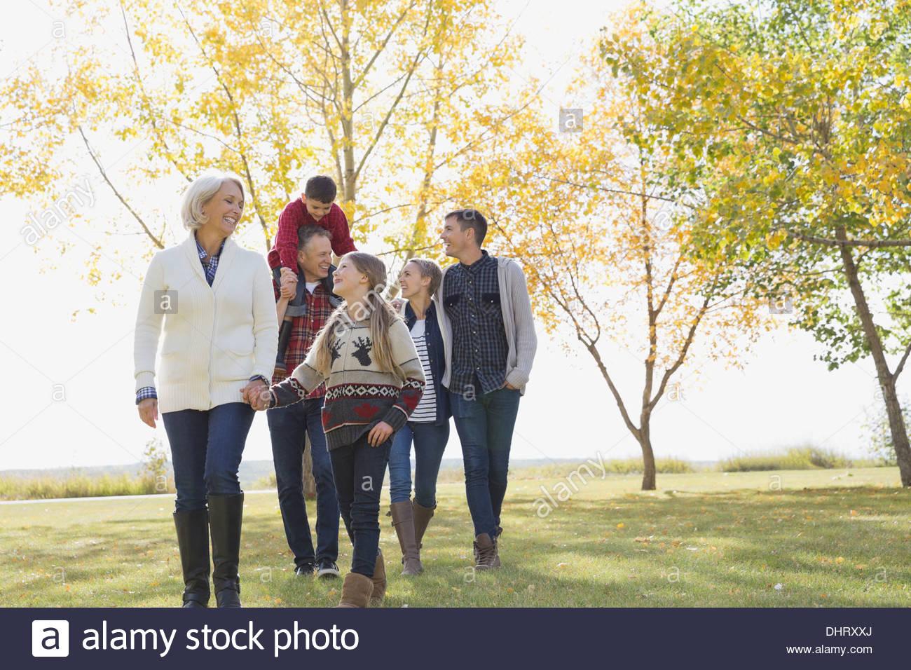 Happy multi-generation family walking in park - Stock Image