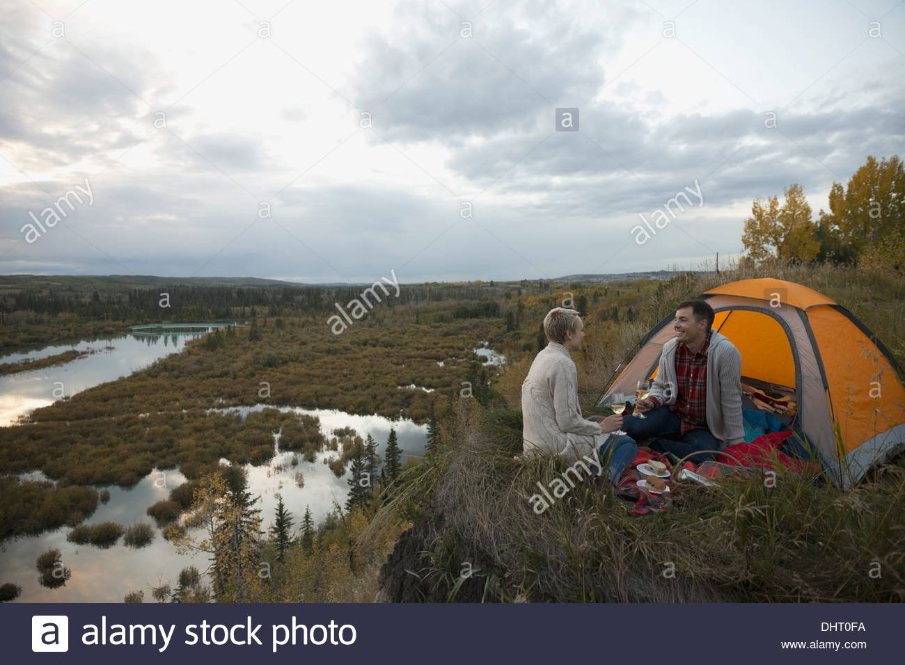 Couple camping by lakeshore - Stock Image